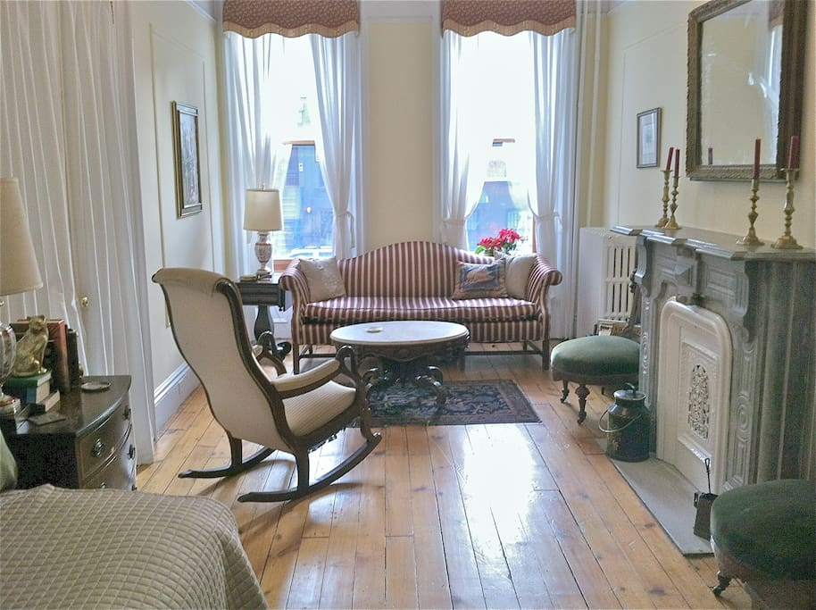 Private victorian living room with day bed. Another day bed can be set up for additional persons.
