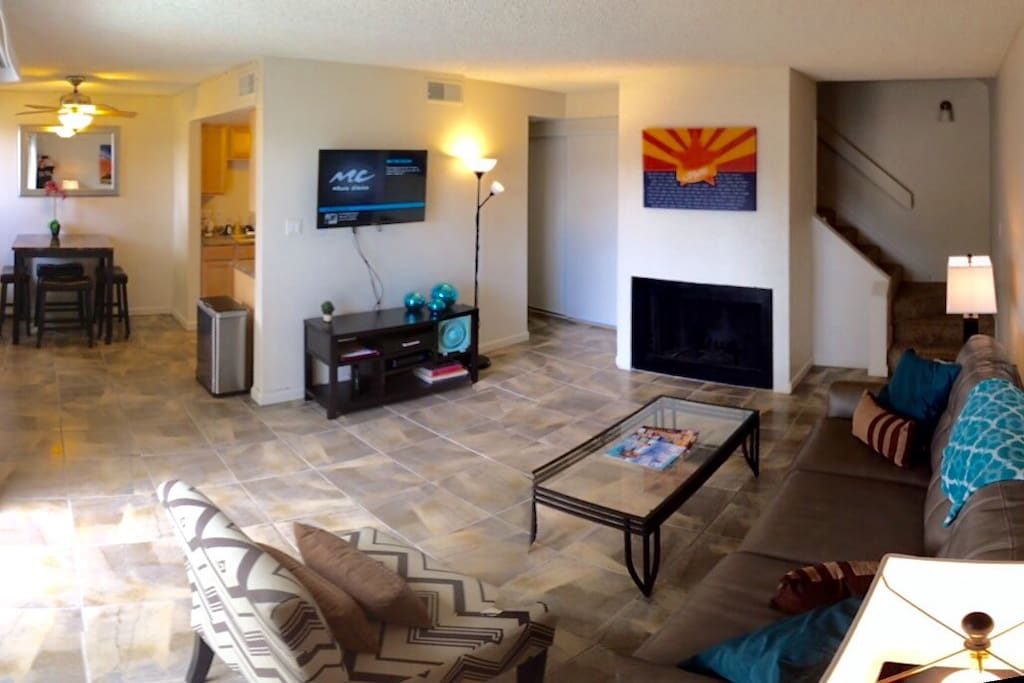 Living room with fireplace. Access to downstairs half bathroom. Patio with sliding door. Kitchen and dining area. Flat screen tv with cable. Internet and wifi available. Stackable Washer and dryer in closet.