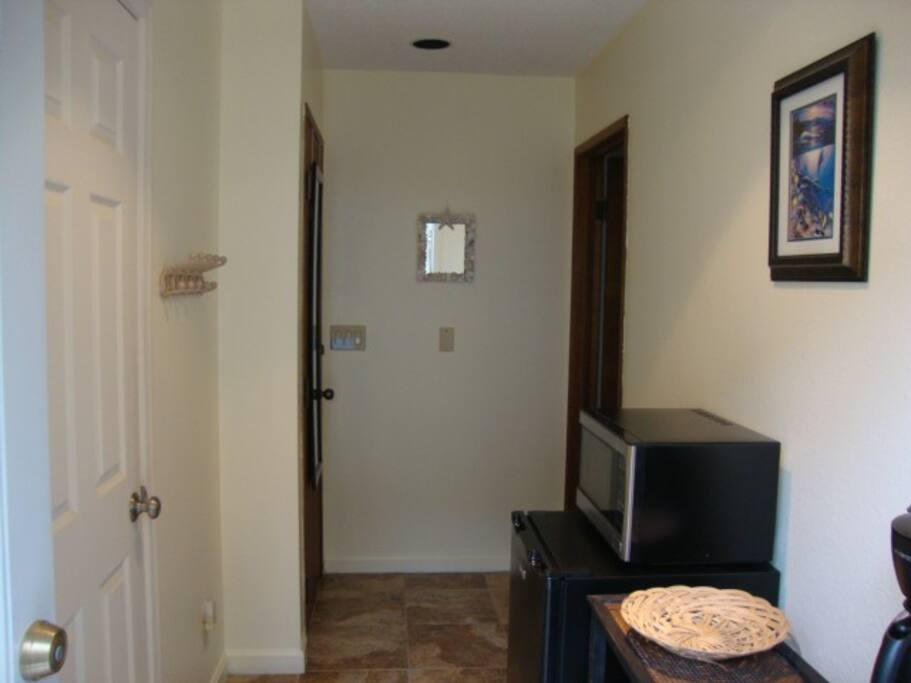 This is the view of the kitchenette area as you enter the door.  Large refrigerator and microwave