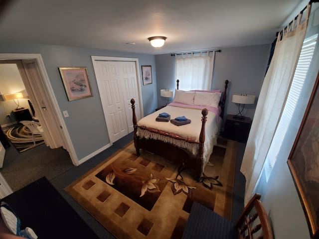 Our queen size bed with a pillow top mattress, a night stand on each side with lamps that have plug-ins for easy access for chagering your electronics. With a beautiful view right outside your window!! Full size closet and dresser too!