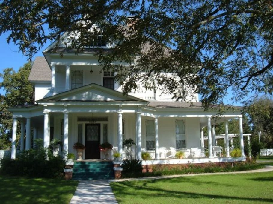 Front of Manor with wrap around porches to sit and relax and watch wildlife.