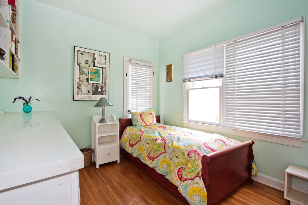 Your new room!  Freshly painted, lots of light, and with access to den, kitchen, office space, and backyard with pool!