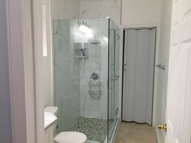 Blue room with private shower room in New house