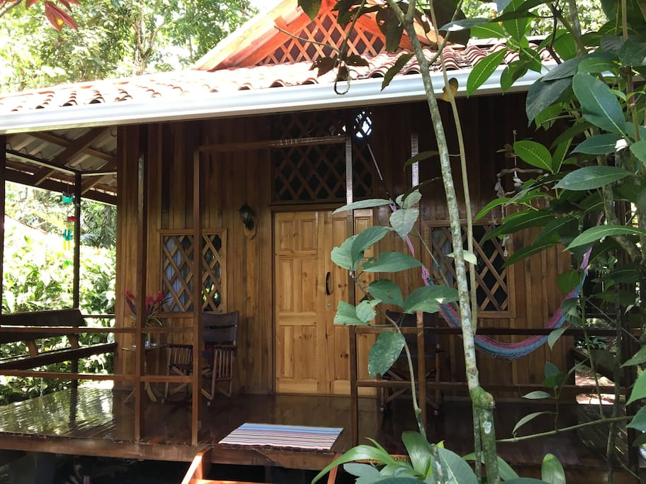 Open, airy bungalows tucked under a canopy of trees