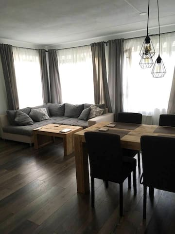 Living room with sofa that can convert to big double bed