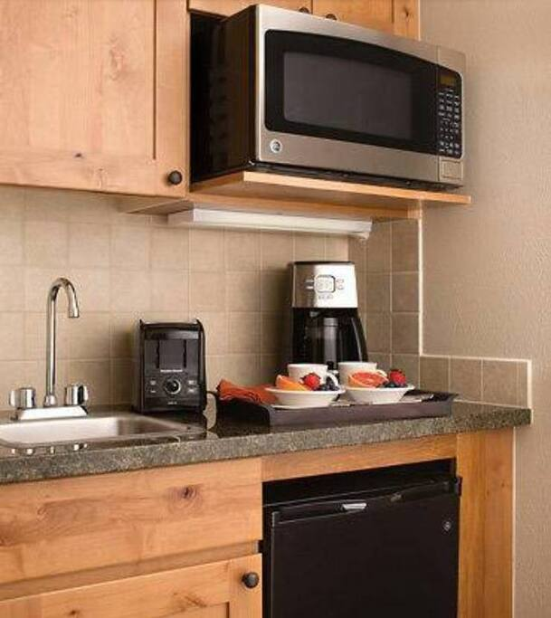 Kitchenette with microwave, mini-fridge, coffee maker, toaster, dishes/utensils