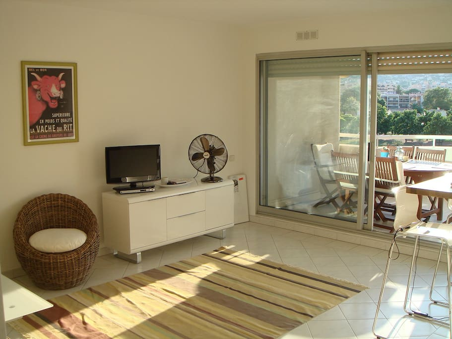 Living room with TV, DVD player and fan (great in summer)