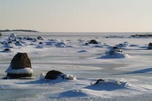 The frozen Baltic with a view over the islands outside the harbour on a beautiful winter day