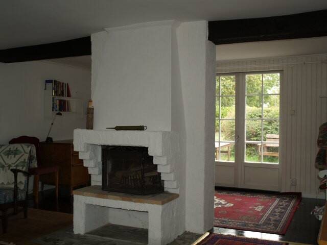 Fireplace in downstairs living room and doors opening out to the garden patio