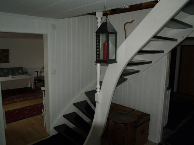 Stairs to the upper floor with bedrooms and living room