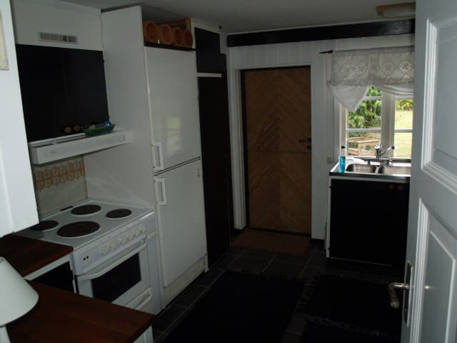 Fully equipped kitchen and dividing door to the garden patio