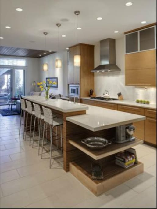 Custom Chef's Kitchen, close to both the dining room and the outdoor eating area.