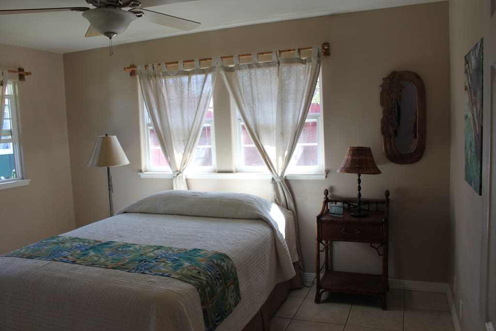 Bright and airy bedroom, with comfortable queen bed and walk in closet.