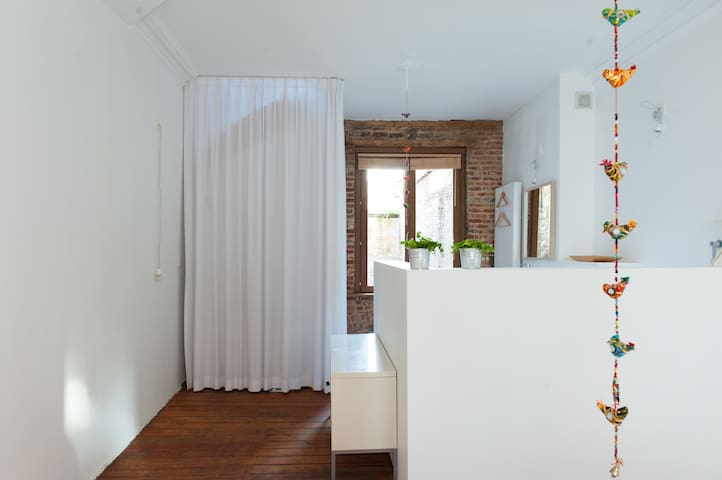 The curtain is replaced by a wall with door that you can lock.
