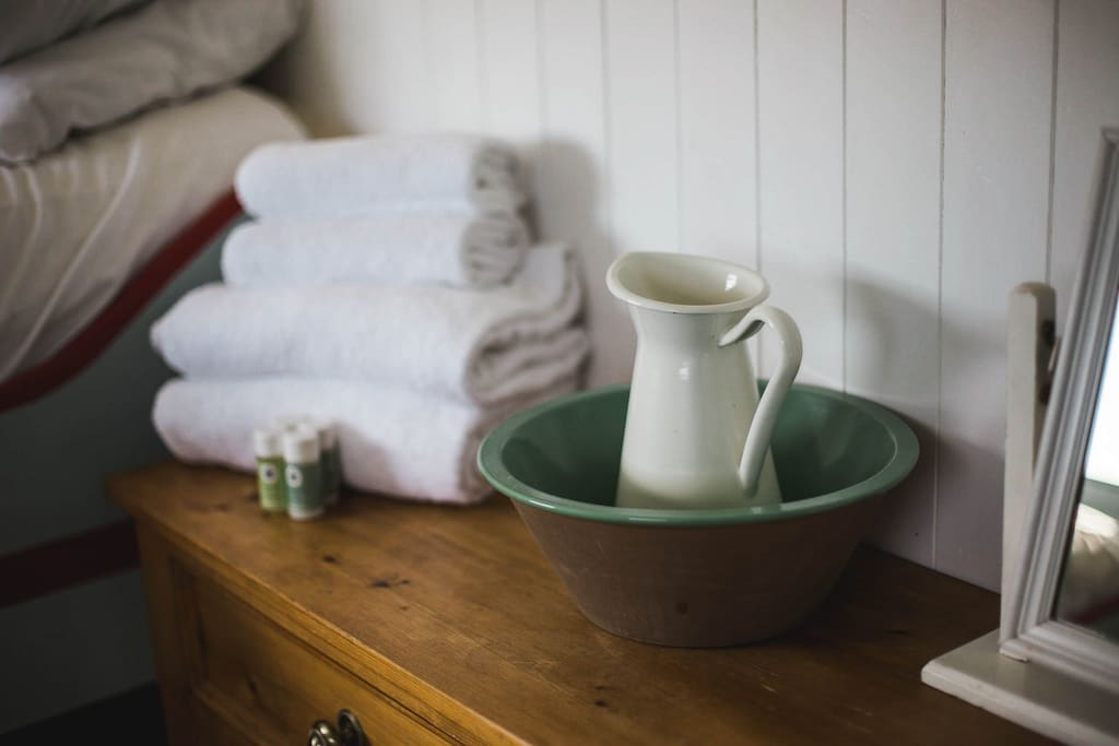 Towels and Handmade Soap Company products are included for your stay