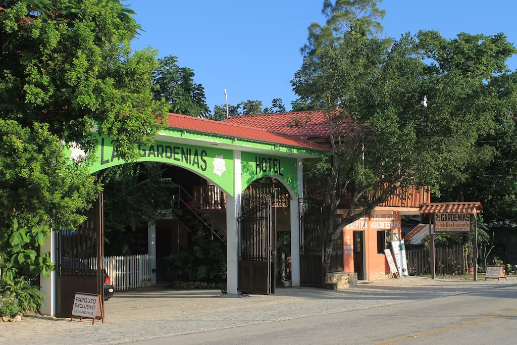 The main entrance. It is easily to find, just take a minibus from Santa Elena, Flores to El Remate on main road to Tikal. Las Gardenias'