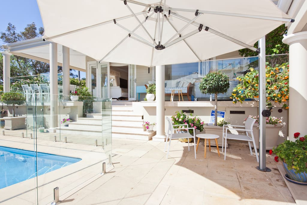 The tiled area around the pool offers an umbrella and access to the cabana.