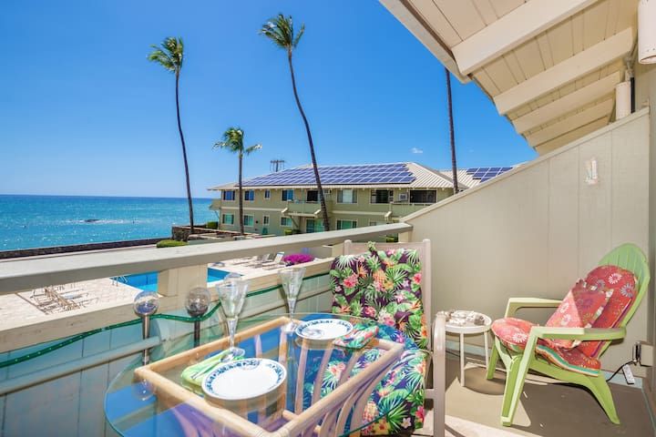 Your private lanai features sweeping ocean views with a view of the pool, perfect for relaxing and outdoor dining.
