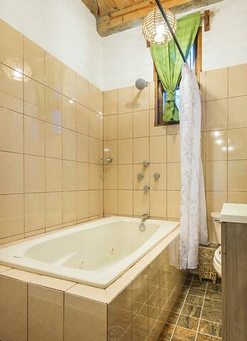 Private bathroom fully equipped and functional with hot water and hot tub with hydro massage