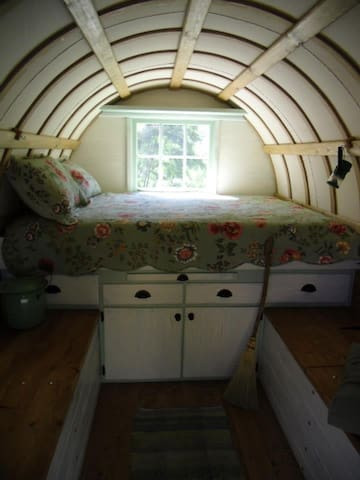 View as you enter the wagon.  The bed is queen size with a memory foam mattress.