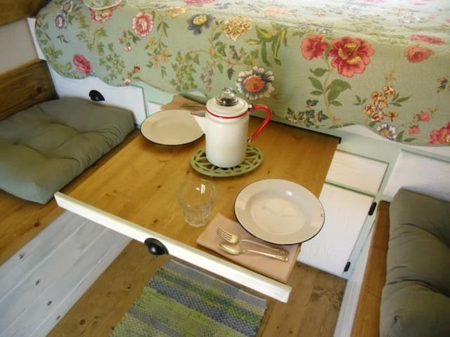 Your table pulls out from under the bed (just above the ample storage area for your luggage, backpacks, fishing gear, etc.)