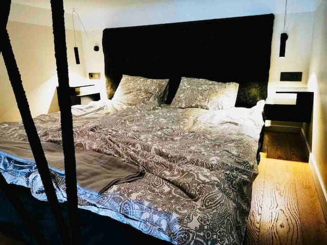 King size orthopaedic mattress (180×190 ). On the sides are located bedside tables and reading lamps.