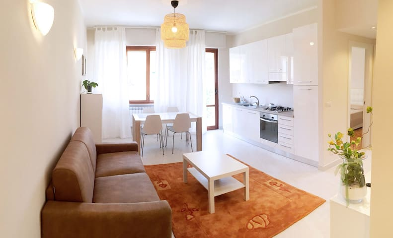 """Apartment 23"" Bright and Cozy + Private Parking"