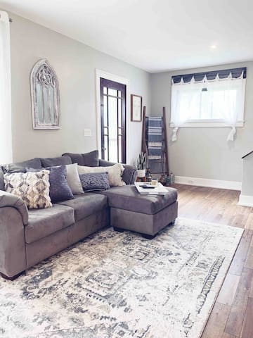 Living room space, couch with recliner and bean bag chair - for those like me who love a good rug, this one is the best!