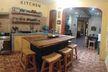 """Kitchen and dining areas. """"We felt as though we were in a combination of an art gallery, Frida Kahlo's house in Mexico City and a home away from home!"""" --Avra"""