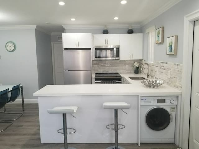 Well lit kitchen with all upgraded amenities.