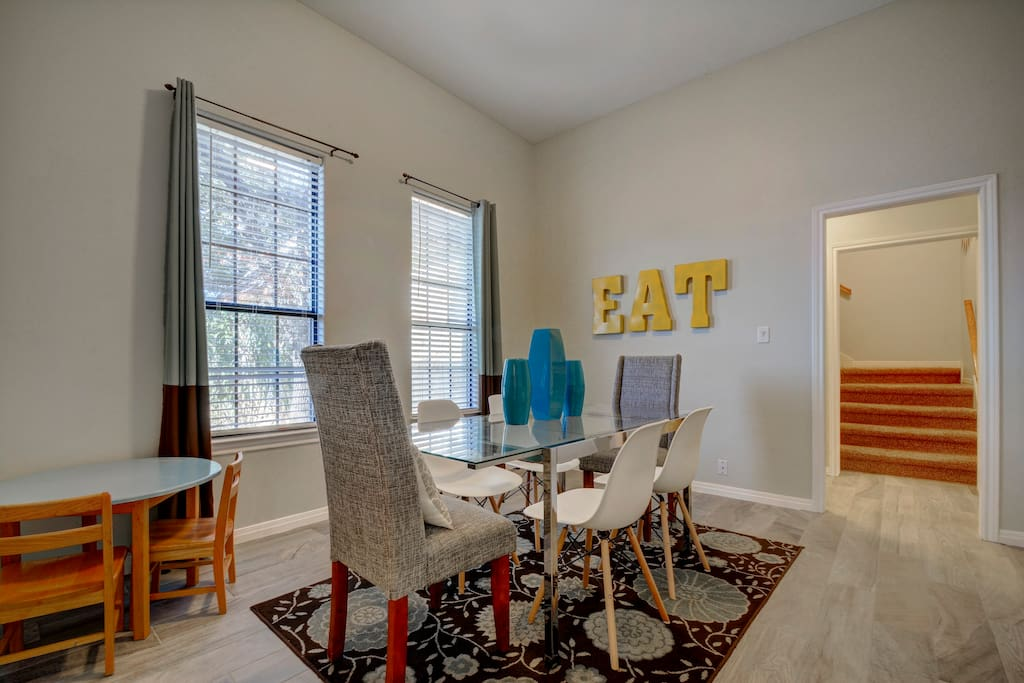 Sit down to a good old-fashioned family dinner around the eclectic 6-person dining table