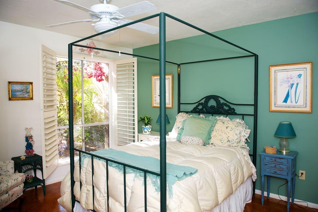 Bright cheerful guest room #1.  Walk in closet.  Private bath.
