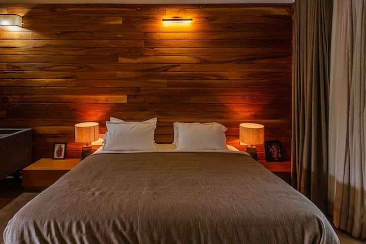 Bedroom 2 with wooden interiors and cozy beddings