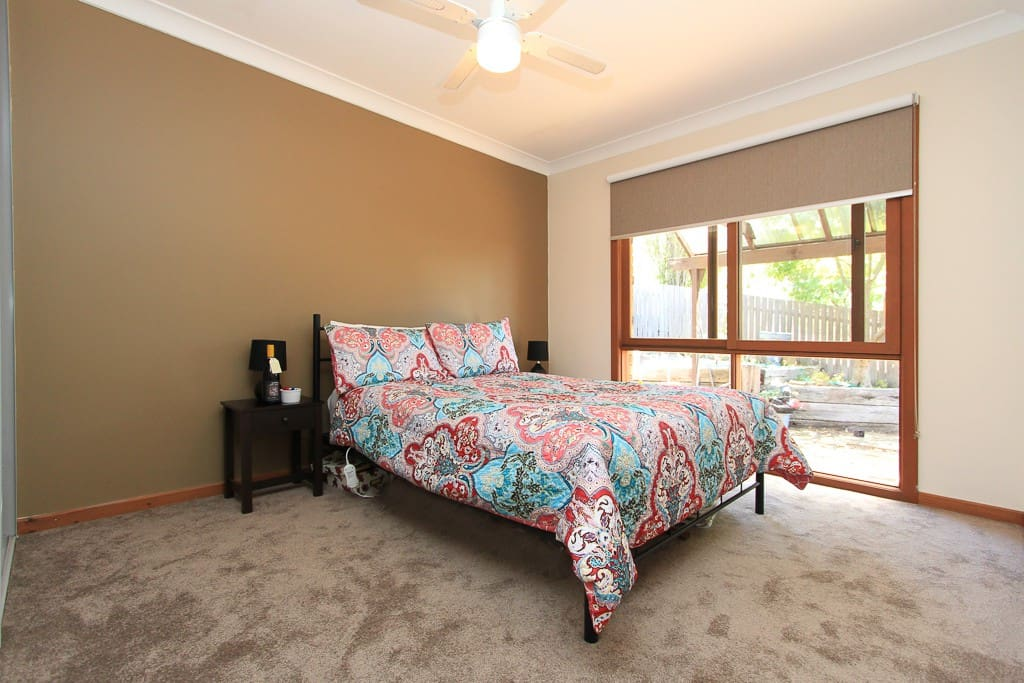 Sun filled double bedroom with quality linen and ample space.