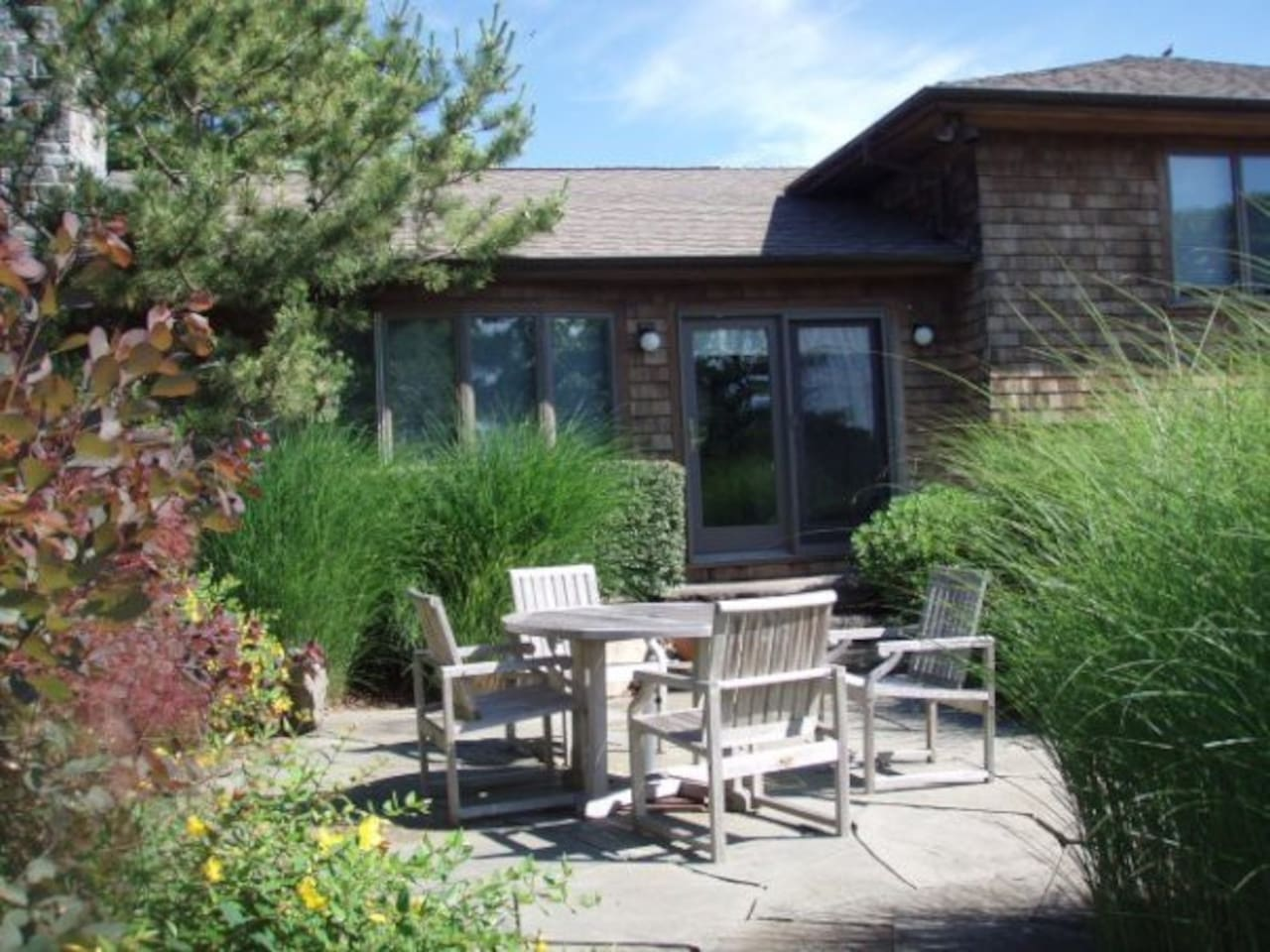 Gorgeous front yard with space for your morning coffee or any time!