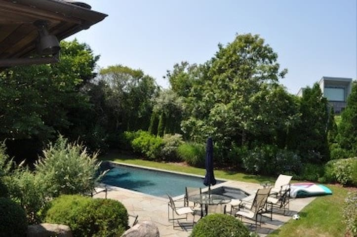View of the pool from the master bedroom deck.  Privacy in the backyard is fabulous.