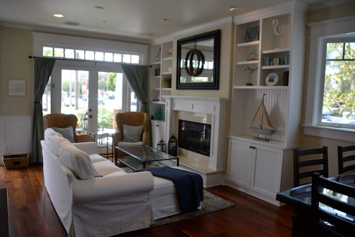 French doors open up to porch and front courtyard that includes a stainless steel gas BBQ.