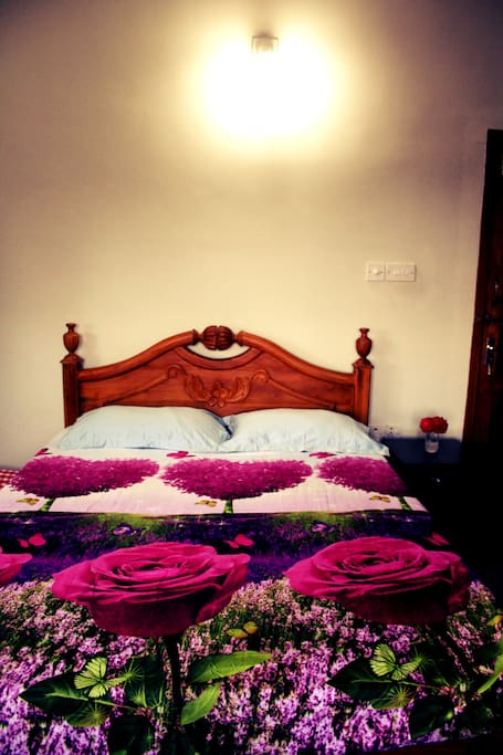 Bed space with floral bedsheet