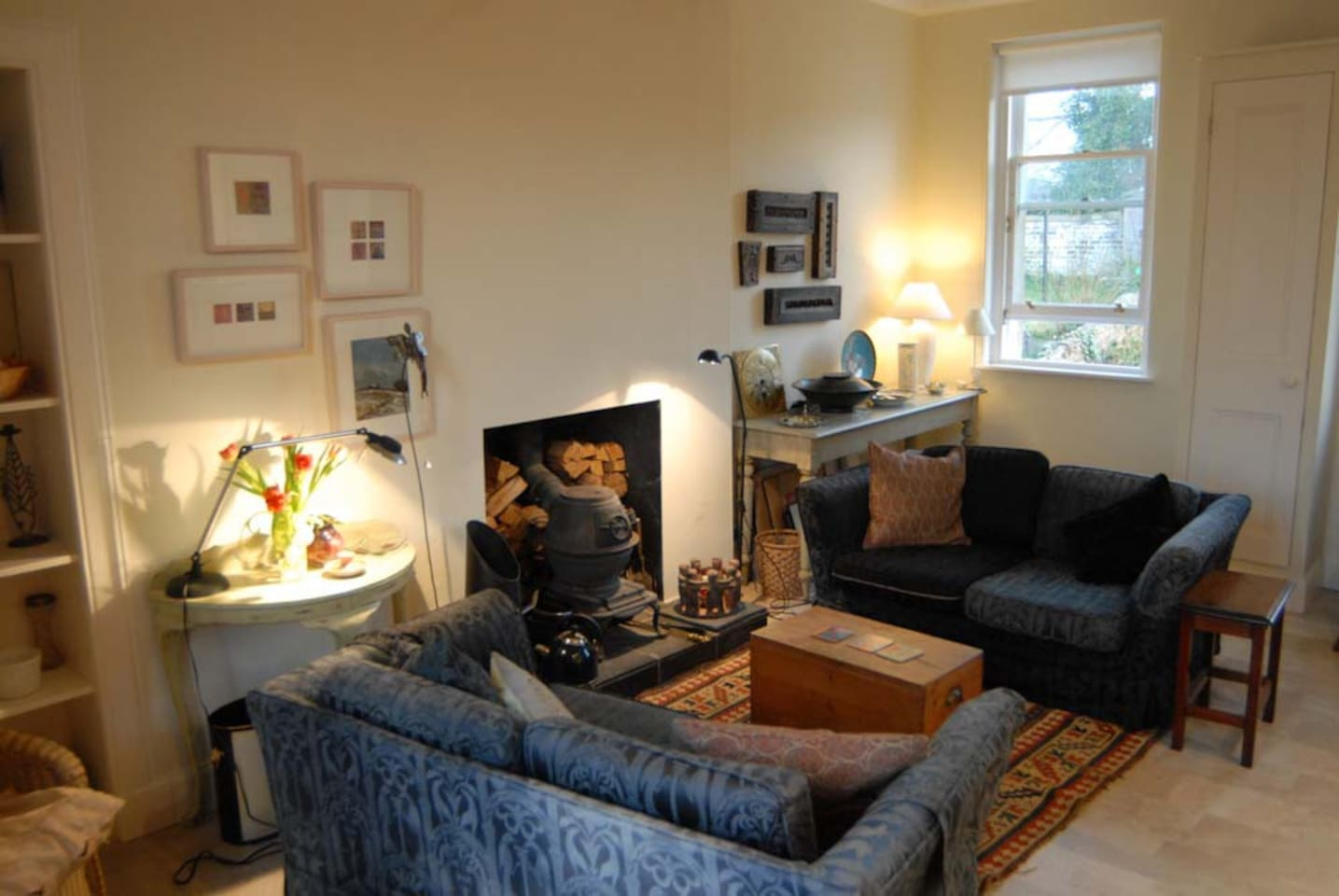 Sitting room with log stove, south-facing, catches the sun