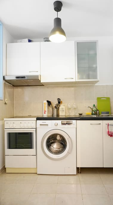 The kitchen is fully equipped and provides a washing machine.