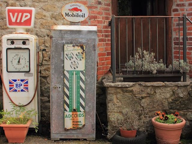 Old petrol pumps at the entrance of The Smithy