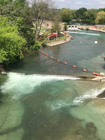 Comal river park entrance is crowded with tubers every summer about 1/2 mile from Gruene.