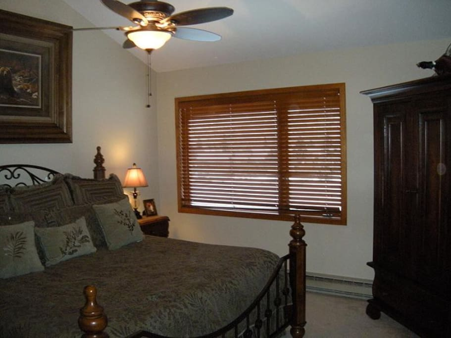 Unit B King Bed Master Bedroom with Flat screen TV,  ceiling fan, private bathroom