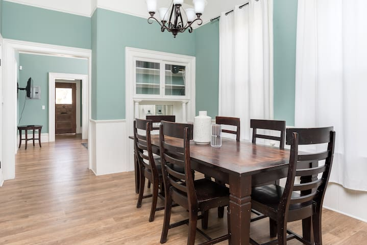 Large dinning room has seating for up to 8.