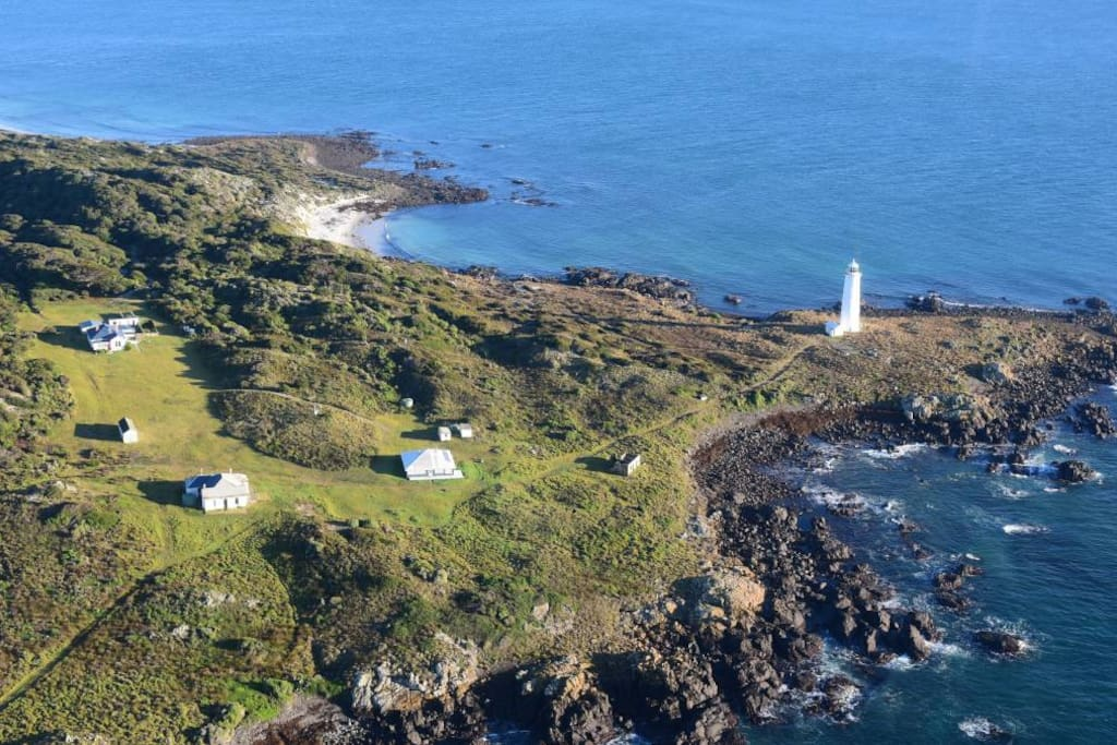 The houses from the sky. The property for rent is the one closest to the lighthouse. The other homes will be empty as you will have the island to yourself.