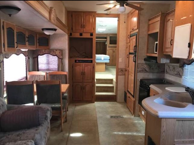 Luxury RV in a private yard with pool!