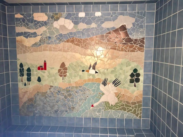 Bath with mural of Chico Buttes