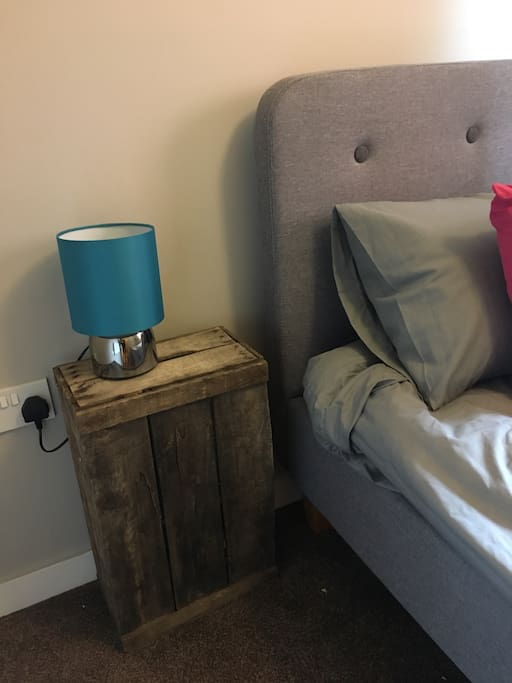 A touch lamp and vintage crate.