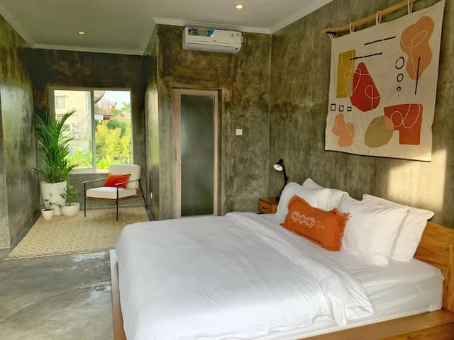 Second bedroom located on the second floor, balcony & rice fields view.