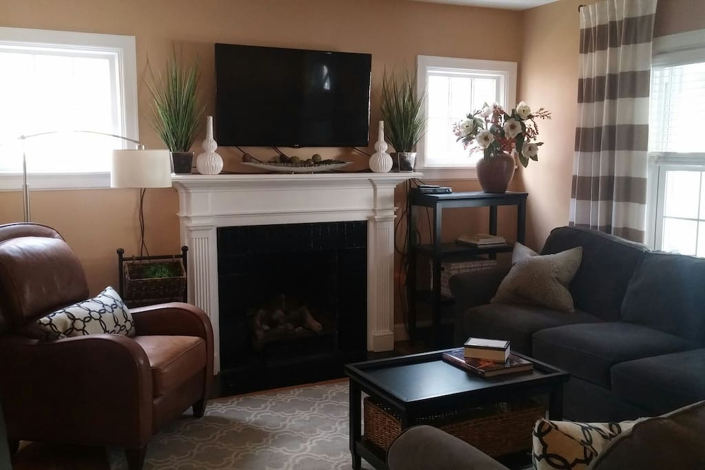 Gas fireplace and mounted TV are focal in the first level living area